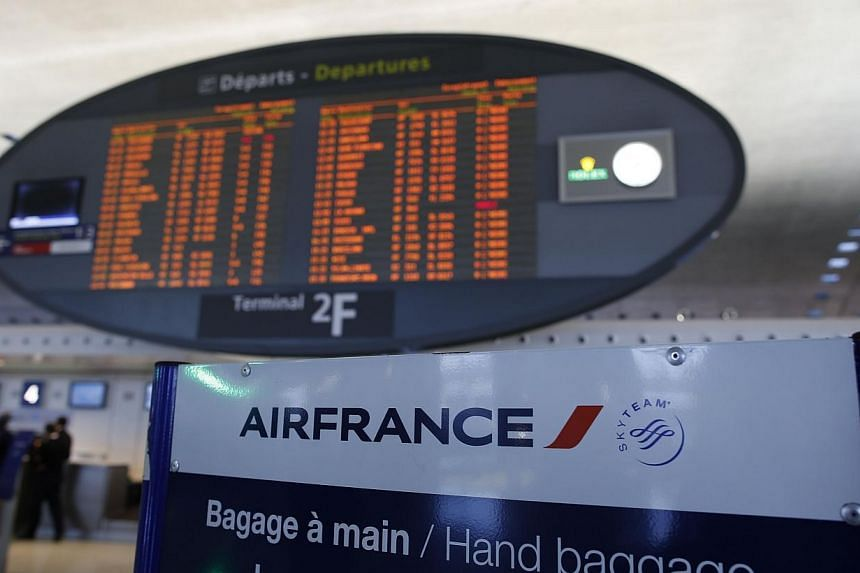 This photo shows the Air France check-in hall and a departing flight timetable at the 2F terminal of Paris-Charles de Gaulle airport in Roissy, north of Paris, on Sept 15, 2014. -- PHOTO: AFP
