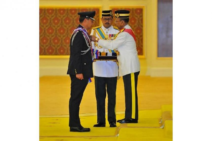 The commissioner of the Singapore Police Force received  the highest Malaysian award for police officers from the Malaysian King on Monday. -- PHOTO: SINGAPORE POLICE FORCE