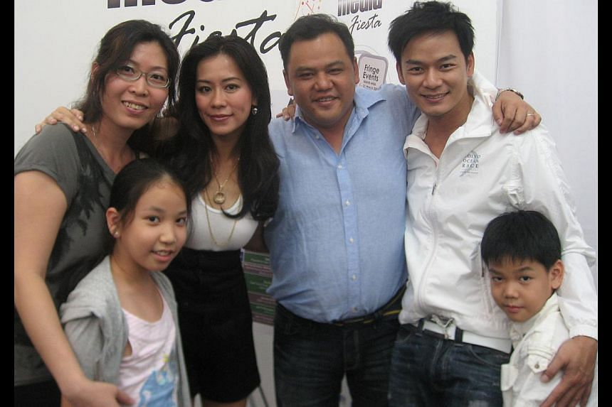 Low with (from left) wife Vanda Tan, daughter Naomi, Perfect Cut's Michelle Chia and Thomas Ong and son Shannan in 2009. -- PHOTO: COURTESY OF MOLBY LOW