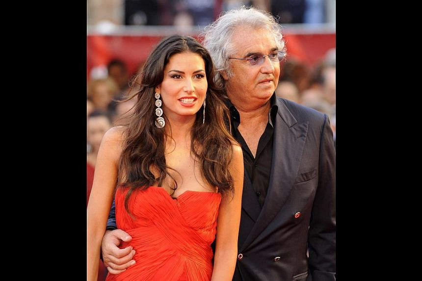 Billionaire Couture's Flavio Briatore on the name of his label. He has a daughter with supermodel Heidi Klum and is now married to ex-Wonderbra model Elisabetta Gregoraci (above, left). -- PHOTO: AGENCE FRANCE-PRESSE