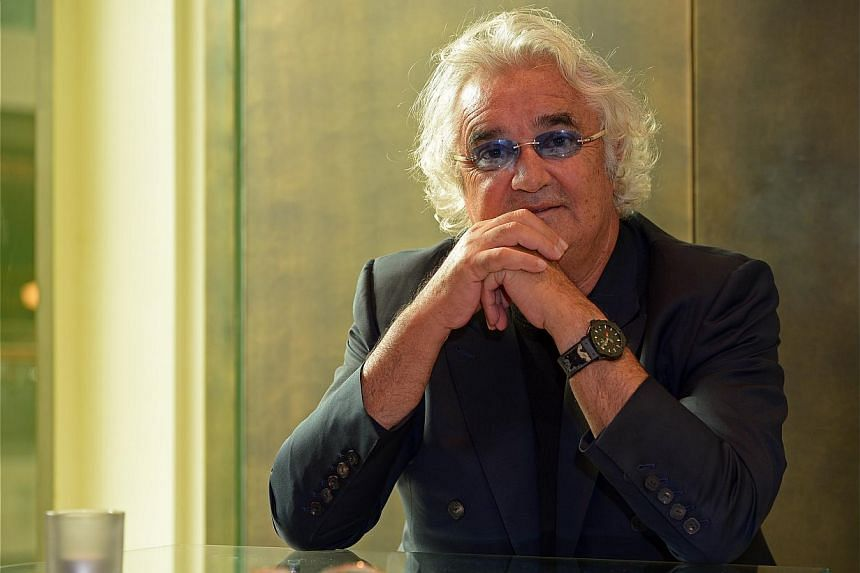 Billionaire Couture's Flavio Briatore (above) on the name of his label. He has a daughter with supermodel Heidi Klum and is now married to ex-Wonderbra model Elisabetta Gregoraci. -- PHOTO: DESMOND WEE