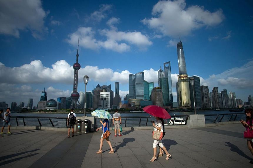 Nearly half of China's super-wealthy individuals are considering leaving the country, a survey said Monday, with most citing better overseas educational and employment opportunities for their children. -- PHOTO: AFP