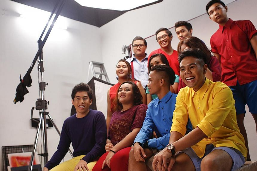 Students from the ITE show choir pose for photographs during a photography session for the ChildAid 2014 programme booklet on Sept 11, 2014. -- ST PHOTO: DESMOND LUI