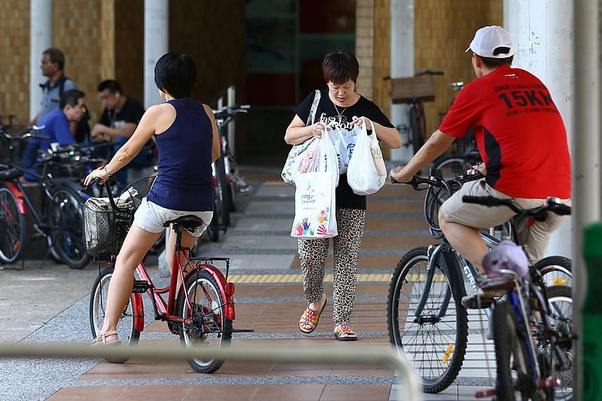 There are many cyclists in Bedok Town Centre which is a popular shopping precinct with high pedestrian traffic. -- PHOTO: ST FILE
