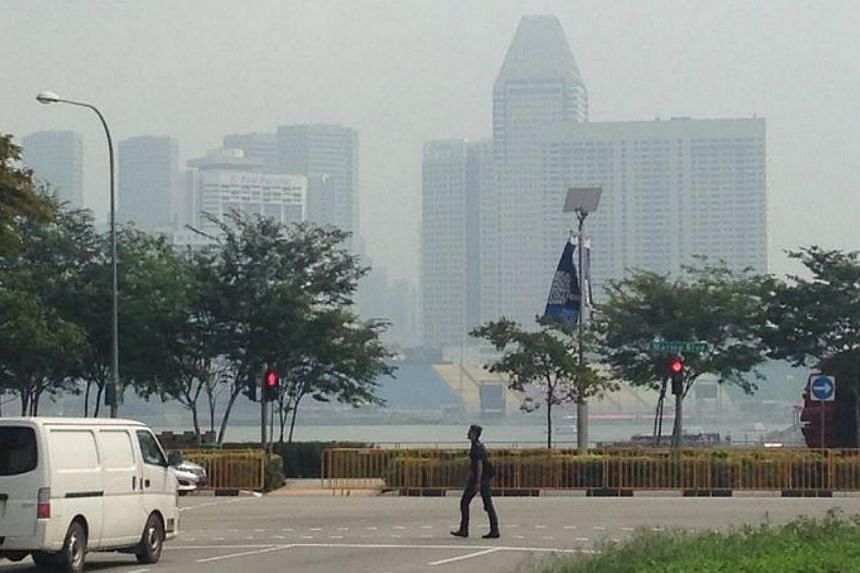 A photo taken here on Monday morning at 11 am. The National Environment Agency has said that Singapore's air quality will remain unhealthy or close to unhealthy for the rest of day. -- ST PHOTO: RUDY WONG