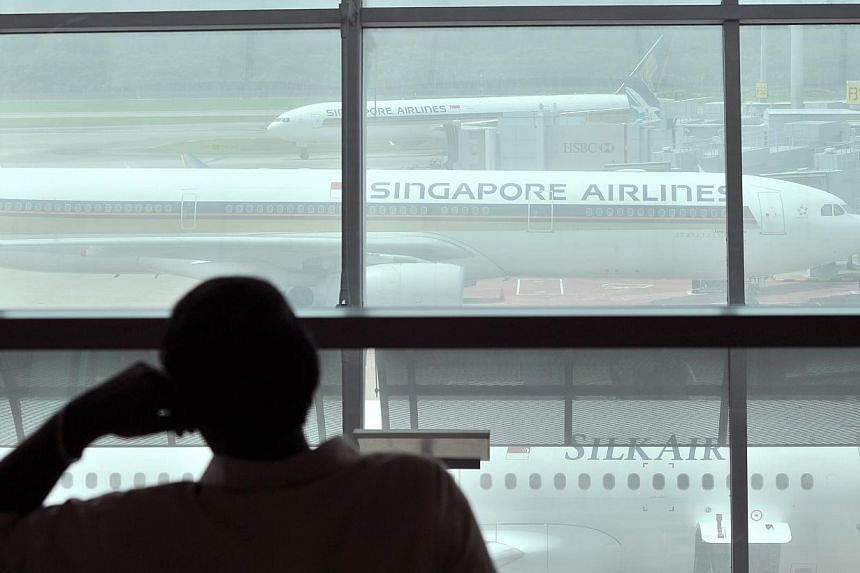 Singapore Airlines plane at Changi Airport on July 18, 2014. -- PHOTO: ST FILE