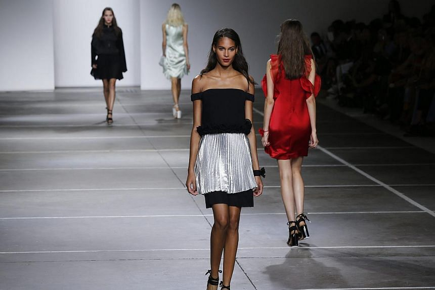 Models present creations from the Topshop Unique Spring/Summer 2015 collection presentation during London Fashion Week on Sept 14, 2014. -- PHOTO: REUTERS
