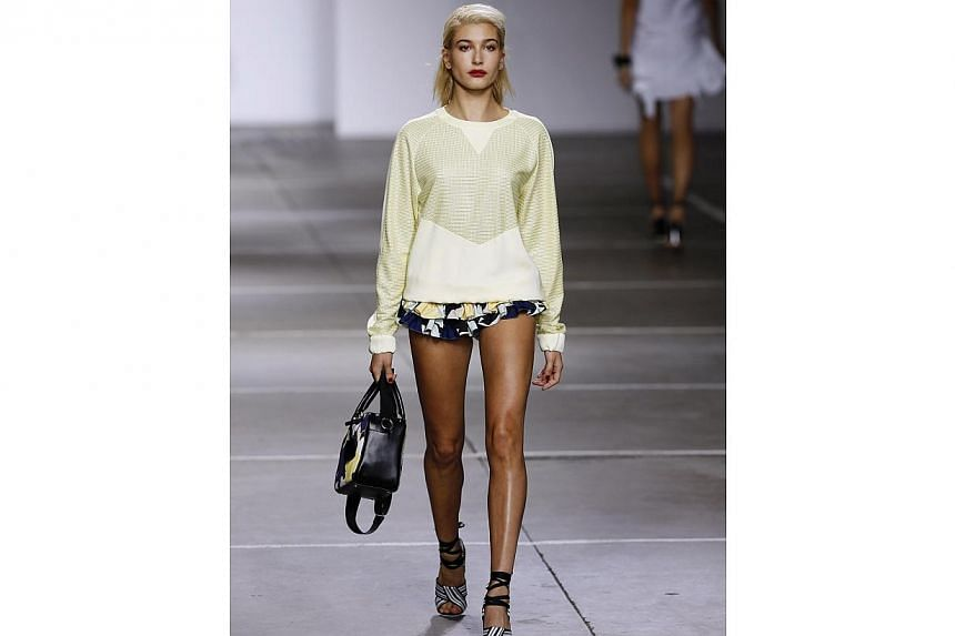 Model Hailey Baldwin presents a creation from the Topshop Unique Spring/Summer 2015 collection during London Fashion Week on Sept 14, 2014. -- PHOTO: REUTERS