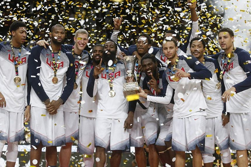 US players celebrate their victory over Serbia after their Basketball World Cup final game in Madrid on Sept 14, 2014. -- PHOTO: REUTERS