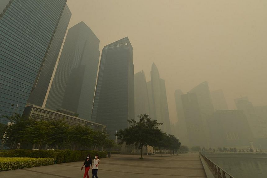Singapore's Marina Bay is shrouded in haze on June 21, 2013. Indonesia's parliament agreed on Monday to ratify the Asean Agreement on Transboundary Haze Pollution. The delay in ratifying the 2002 pact became a sticking point during last year's haze