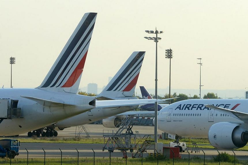 Planes parked on the tarmac of Roissy Charles de Gaulle's airport, during the first day of the French company Air France pilots' strike on Sept 15, 2012. -- PHOTO: AFP