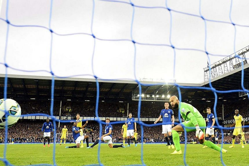 Chelsea's Nemanja Matic (fourth, left) scores a goal against Everton during their English Premier League soccer match at Goodison Park in Liverpool, northern England on Aug 30, 2014. -- PHOTO: REUTERS