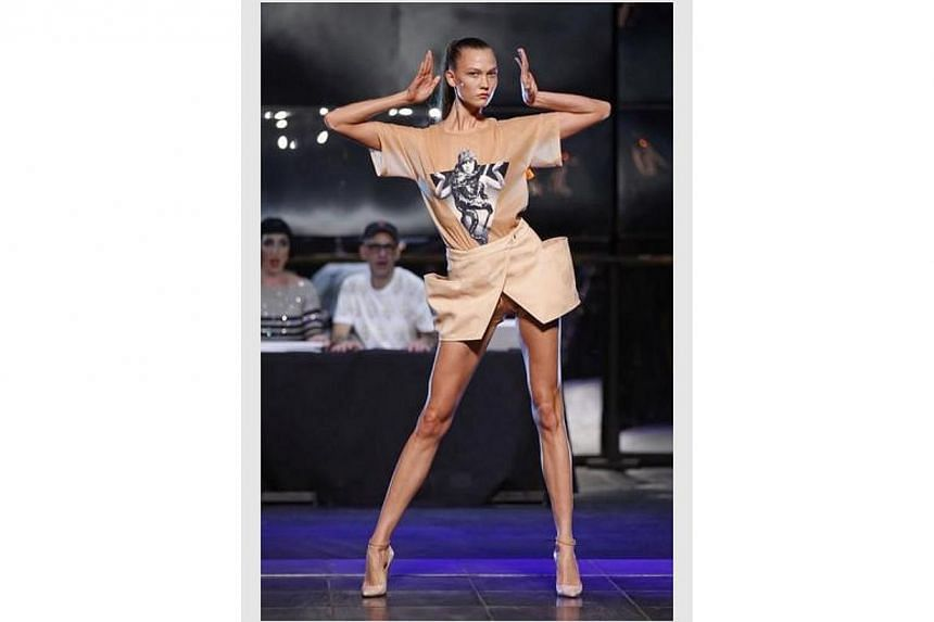 Karlie Kloss presents one of Jean Paul Gaultier's creations from his Spring/Summer 2014 women's ready-to-wear fashion show during Paris Fashion Week , 28 Sept , 2013. -- PHOTO: REUTERS