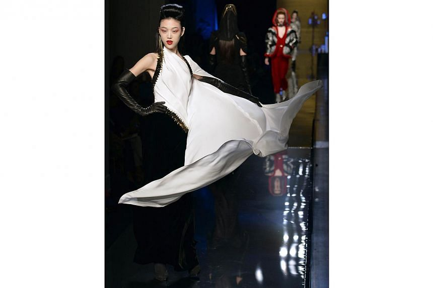 A model presents a creation from the Haute Couture Fall/Winter 2014/15 collection by Jean Paul Gaultier. -- PHOTO: REUTERS