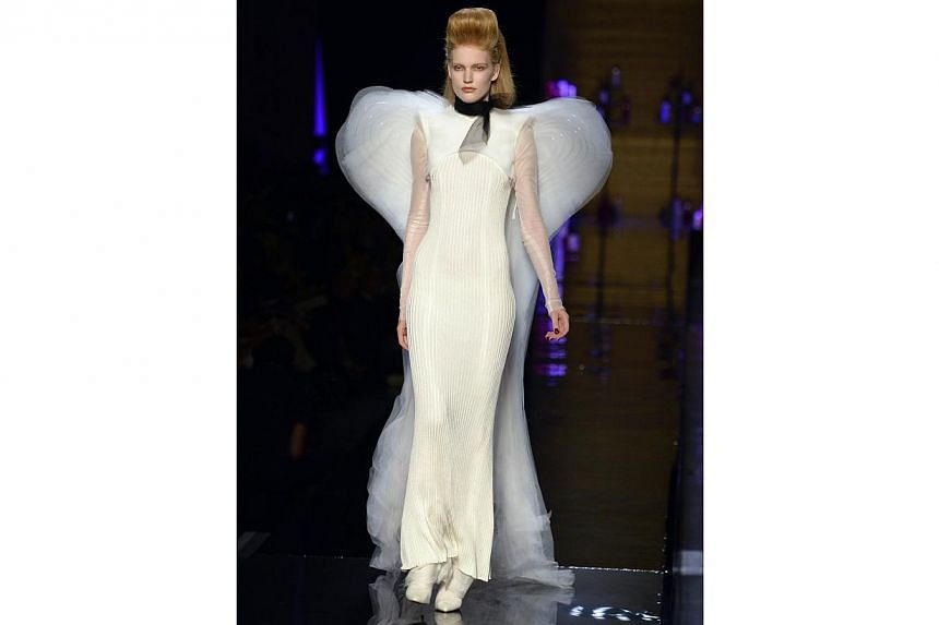 A model presents a creation from the Haute Couture Fall/Winter 2014/15 collection by Jean Paul Gaultier. -- PHOTO: AFP