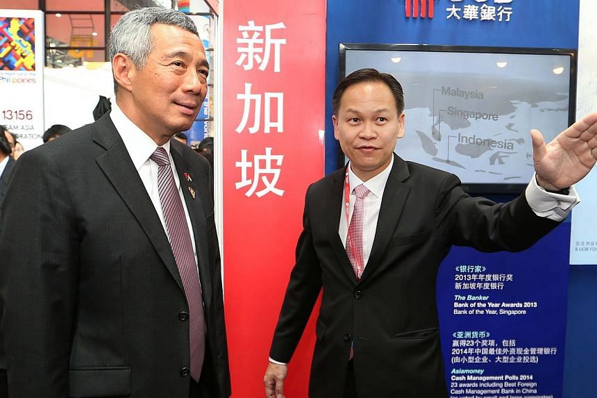Prime Minister Lee Hsien Loong (left) in Nanning, China on Sept 15, 2014. -- PHOTO:MINISTRY OF COMMUNICATIONS AND INFORMATION