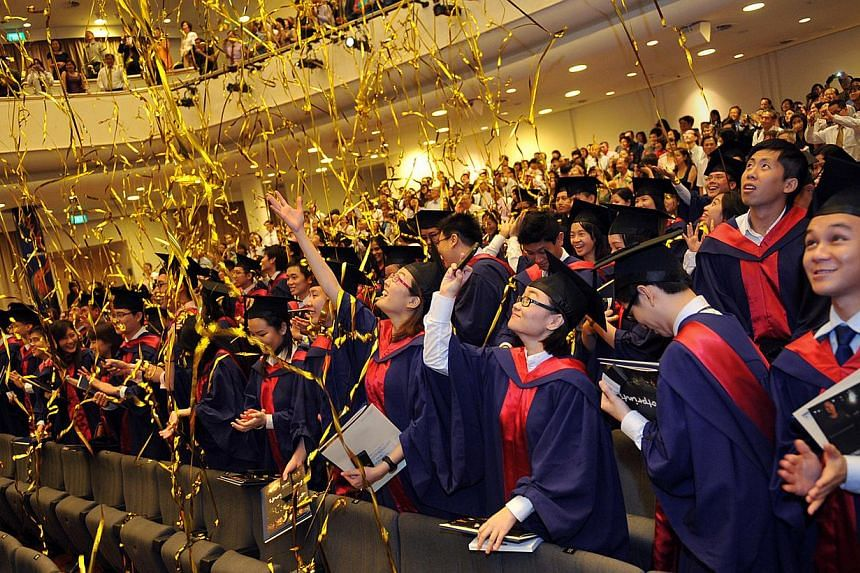 National University of Singapore students at their graduation ceremony in 2011. -- PHOTO: ST FILE