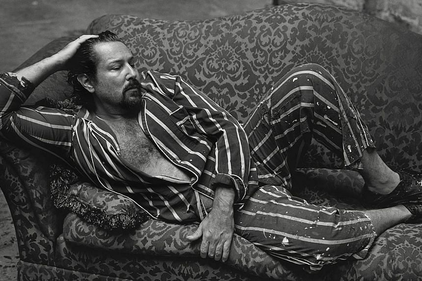 American film director and artist Julian Schnabel (above) is captured in paint-splattered striped pyjamas napping on a couch, while the late pop artist Andy Warhol is framed with a camera in his hand. -- PHOTO: PEARL LAM GALLERIES
