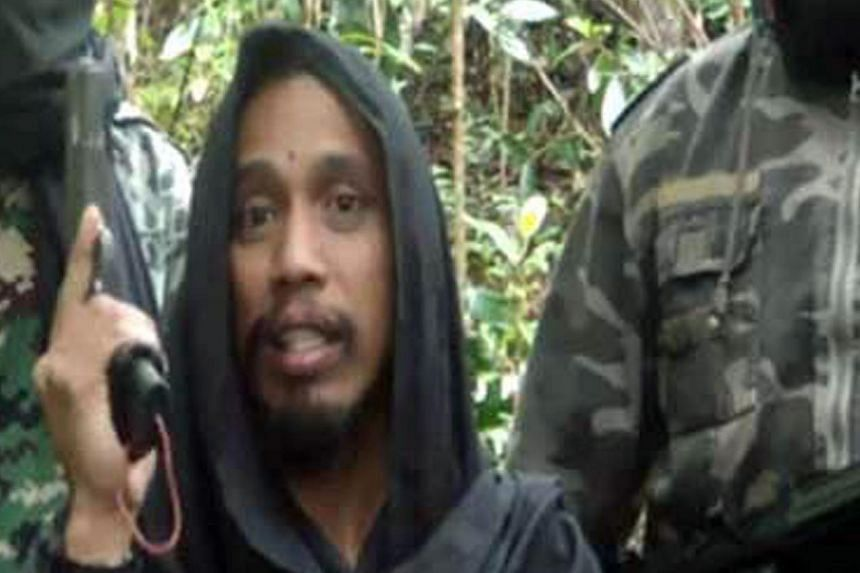 The four Uighurs nabbed in Sulawesi had tried to contact wanted militant Santoso (above).