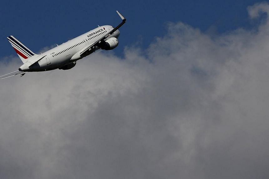 An Air France aircraft takes-off at the Charles-de-Gaulle airport, near Paris, on Sept 16, 2014.The French government called for an end to the Air France pilots' strike, now in its third day, as the dispute over cost cuts threatened 60 per cent