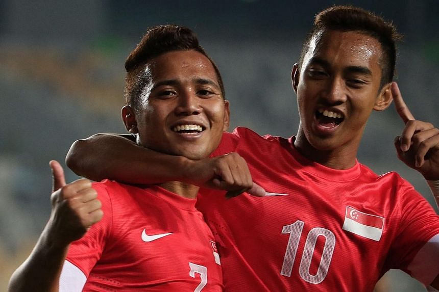 Singapore's Sahil Suhaimi (left) celebrates with team mate Faris Ramli (right) after scoring the first goal for Singapore. -- ST PHOTO: NEO XIAOBIN
