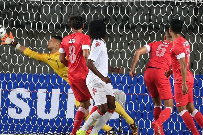 Singapore's goalkeeper Hassan Sunny (in yellow) saves a shot on goal from Oman during the 17th Asian Games Incheon 2014 football group stage held at the Hwaseong Sports Complex Main Stadium on Sep 17, 2014. -- ST PHOTO: NEO XIAOBIN