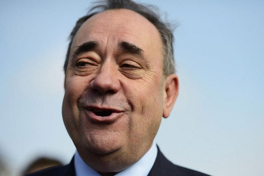 Scotland's First Minister Alex Salmond speaks to the media during canvassing in Dyce, Aberdeen, northern Scotland on Sept 12, 2014.Alex Salmond wields no claymore sword and appears only sparingly in a kilt, and yet he has brought Scotland close