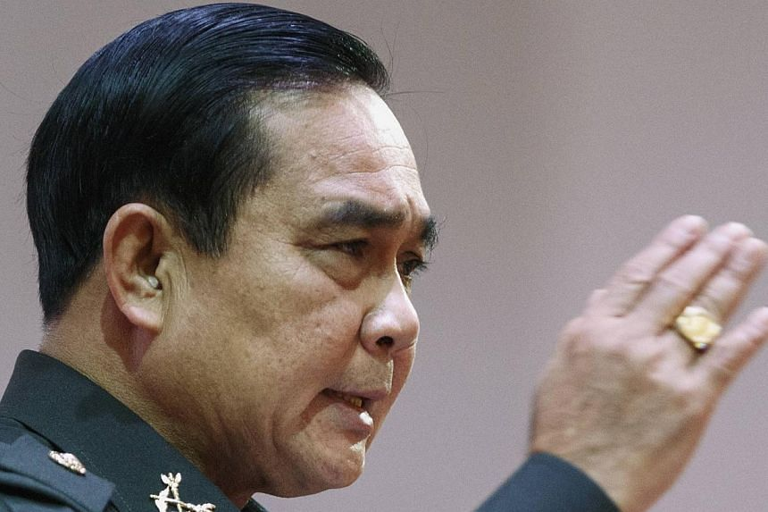 Thailand's military ruler Prayuth Chan-ocha, seen here (above) in August, on Wednesday questioned whether tourists in bikinis are safe in the kingdom, in comments following the murder of two Britons whose battered bodies were found on a Thai island.