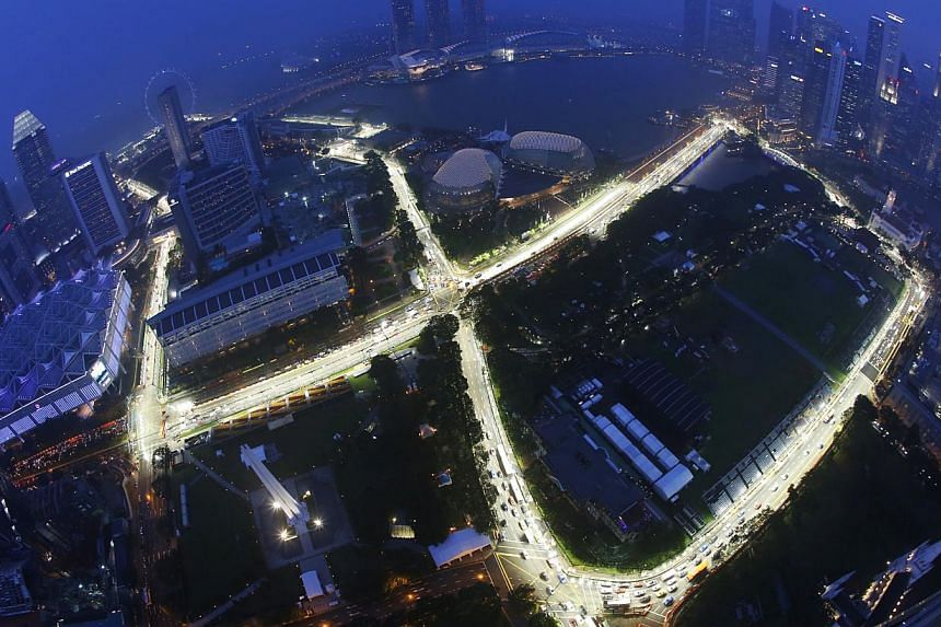 Marina Bay Street Circuit for the 2014 Formula One Singapore Airlines Singapore Grand Prix as seen at dusk and in rainy conditions from Swissotel The Stamford on Sept 11, 2014. -- ST PHOTO:KEVIN LIM