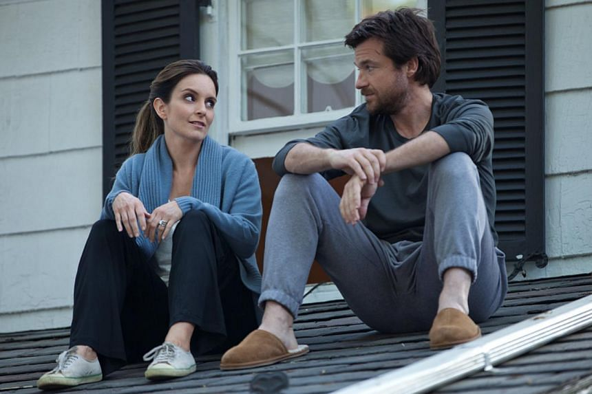 Actor Jason Bateman (with Tina Fey in This Is Where I Leave You) is known for his dry sense of humour which he puts to good use in his roles. -- PHOTOS: WARNER BROS, AGENCE FRANCE-PRESSE
