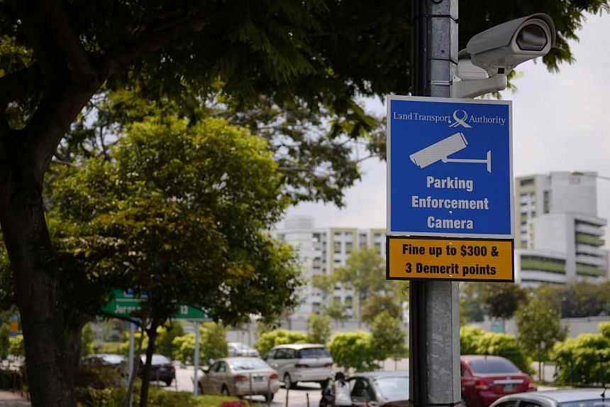 A sign warns about the penalty for parking on a double yellow line in Jurong Gateway in April 2014 in an area monitored by a Land Transport Authority closed-circuit television (CCTV) camera. From Sept 22, 10 more locations on Singapore roads will be