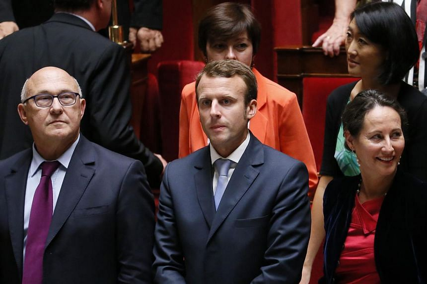 (Left to right) French Finance Minister Michel Sapin, Economy Minister Emmanuel Macron and Minister for Ecology, Sustainable Development and Energy Segolene Royal are seen before the general policy speech of French Prime Minister at the National Asse
