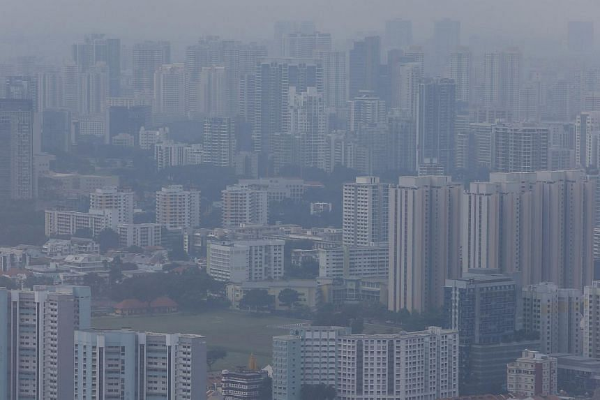 A general view of residential apartments in Singapore's city skyline shrouded by haze on Sept 17, 2014. -- PHOTO: REUTERS