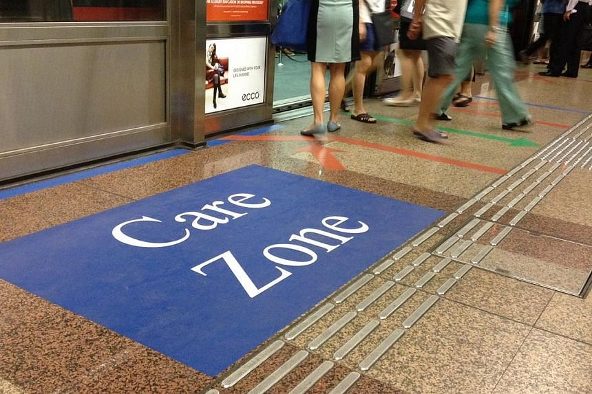 """A dedicated """"care zone"""" on selected rail platforms, and a feedback channel using WhatsApp were launched by SMRT on Wednesday, among a series of four pilot initiatives to make train rides safer and smoother.-- ST PHOTO: ADRIAN LIM"""