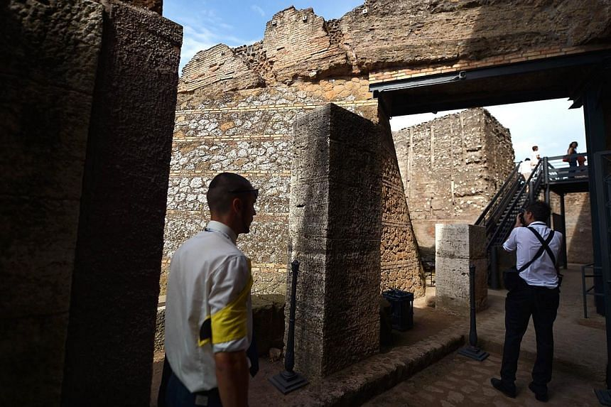 Visitors walk outside of the House of Augustus on the Palatine hill in Rome on Sept 17, 2014.Lavishly frescoed rooms in the houses of the Roman Emperor Augustus and his wife Livia are opening for the first time to the public Thursday, after yea