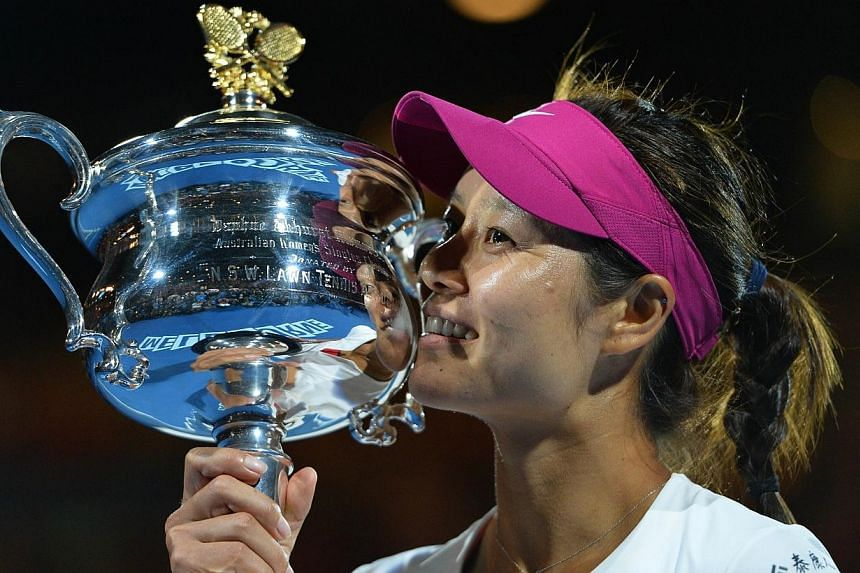 China's Li Na posing with the trophy after her victory against Slovakia's Dominika Cibulkova during the women's singles final on day 13 of the 2014 Australian Open tennis tournament in Melbourne on Jan 25, 2014. -- PHOTO: AFP