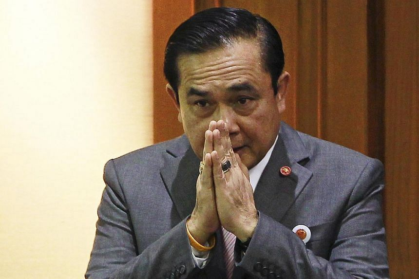 Thailand's Prime Minister Prayuth Chan-ocha gestures in a traditional greeting before reading out his government's policy at the Parliament in Bangkok on Sept 12, 2014. Thai prime minister Prayuth Chan-ocha on Thursday apologised for comments su