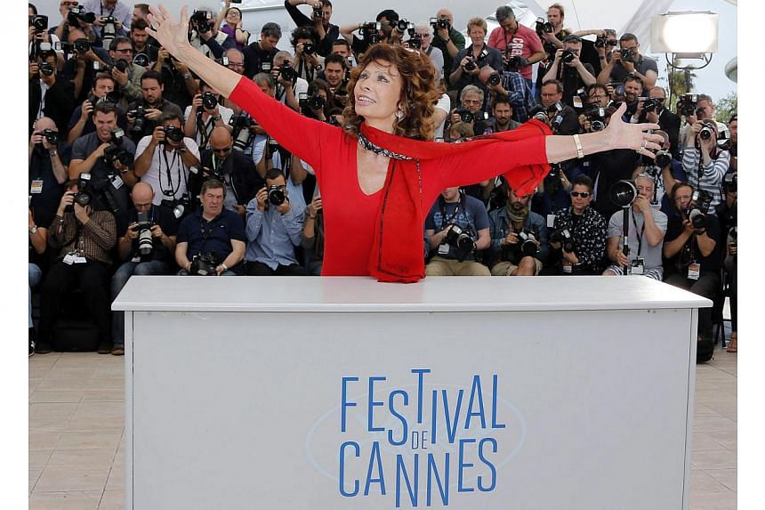 Actress Sophia Loren, guest of honor, poses during a photocall for the film La voce umana presented as part of Cannes Classics at in competition at the 67th Cannes Film Festival in Cannes in this May 21, 2014, file photo. Loren, Italy's national cine
