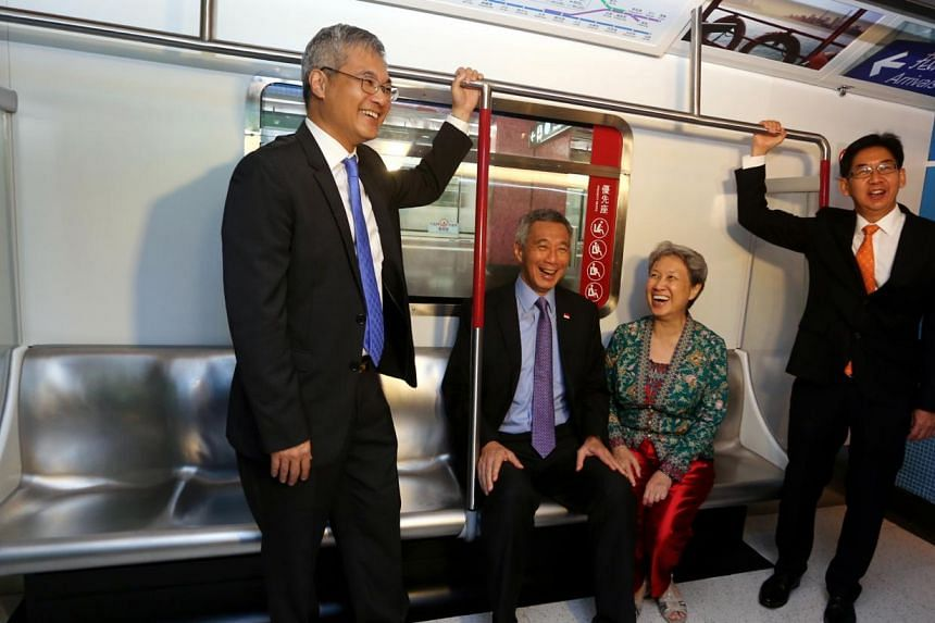 (From far left) Mr Ling Kar Kan, director of the Planning City Gallery; PM Lee; his wife Ho Ching; and Mr Jacky Foo, Singapore's Consul-General in Hong Kong, at an MTR exhibit on Hong Kong's rapid transit rail system, at the gallery. (Below) PM Lee w