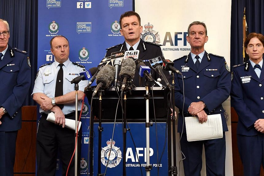 Australian Federal Police Acting Commissioner Andrew Colvin (centre) speaks during a press conference as senior law inforcement officers listen, in Sydney on Sept 18, 2014. -- PHOTO: AFP