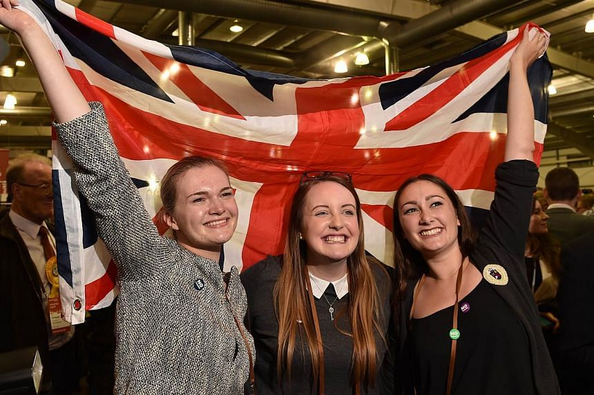 Pro-Union supporters celebrate as Scottish referendum polling results are announced at the Royal Highland Centre in Edinburgh, Scotland, on Sept 19, 2014. -- PHOTO: AFP