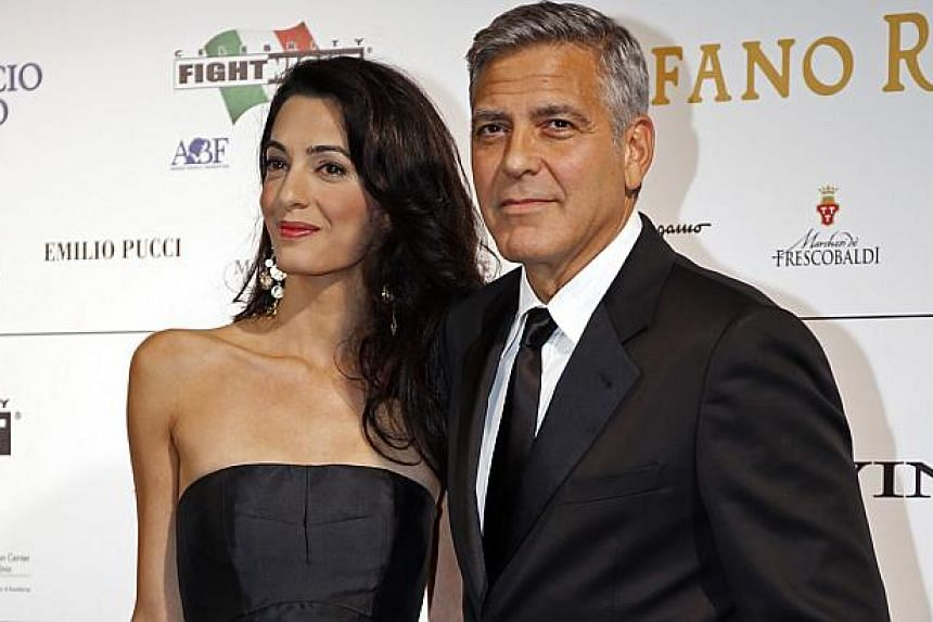 Director and actor George Clooney arrives with his fiancee barrister Amal Alamuddin to attend the Celebrity Fight Night event in Florence on Sept 7, 2014.Matt Damon is expected. So are Brad Pitt, Angelina Jolie, Julia Roberts, Sandra Bullock, E