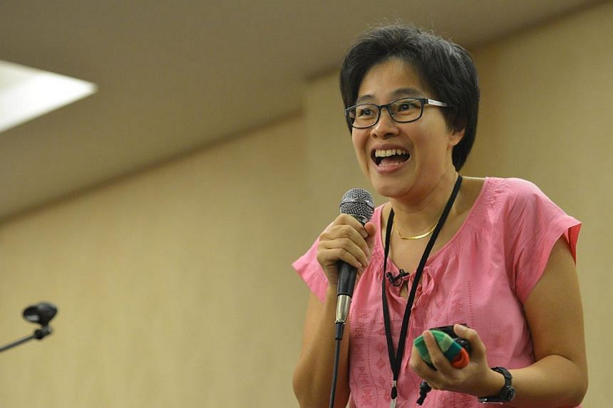 Film-maker Tan Pin Pin having a Q&A session with the audience in Johor Baru. -- ST PHOTO: LIM YAOHUI FOR THE STRAITS TIMES