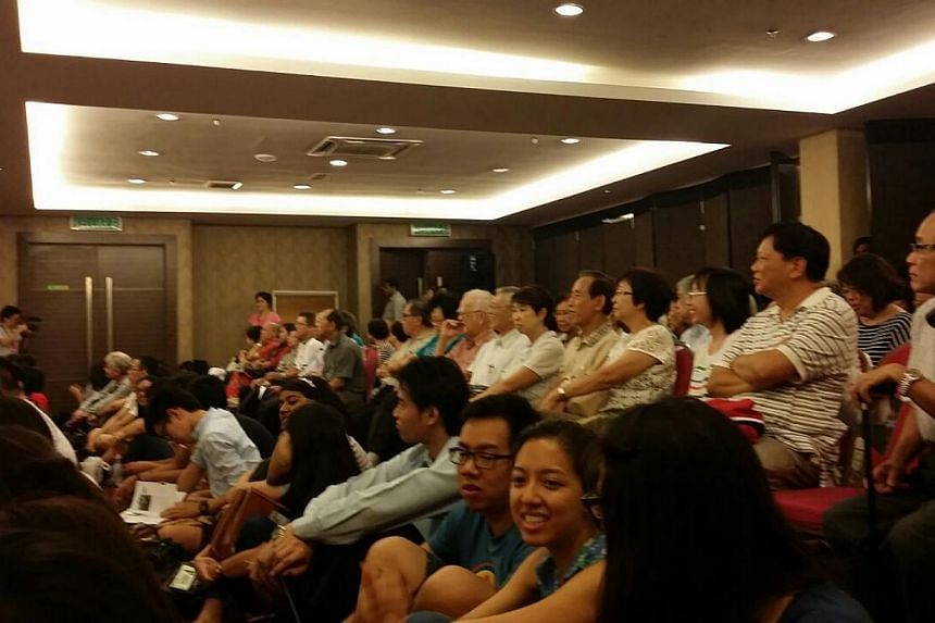 About 50 Singaporeans started to line up to get preferred seats an hour before the screening of a documentary film on Singapore's political exiles which cannot be shown in public or distributed in Singapore.--ST PHOTO: RACHEL AU-YONG