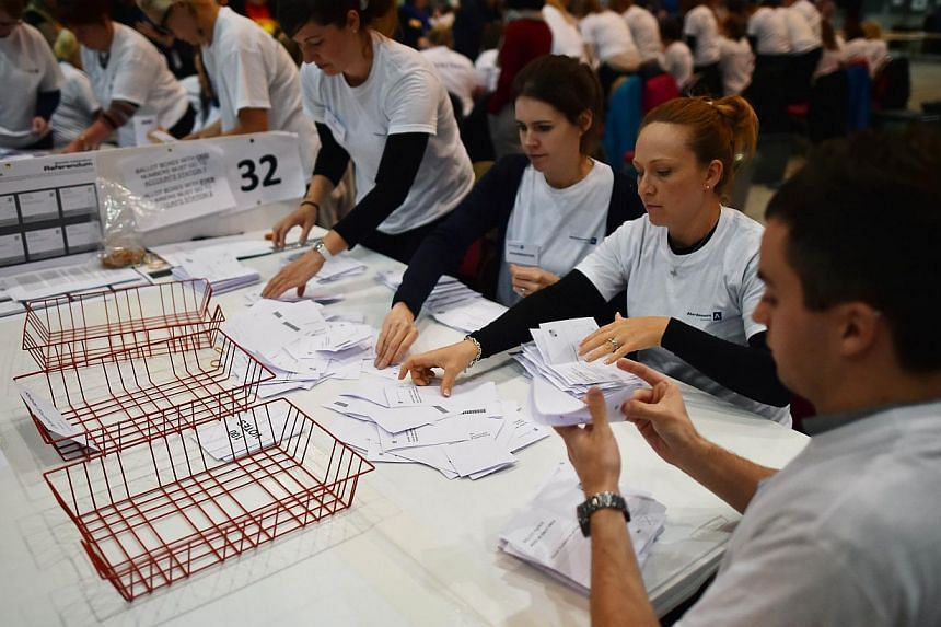 Ballot papers are counted in the Aberdeen Exhibition and Conference Centre in Aberdeen.The first exit poll from Scotland's independence referendum, where ballot stations closed at 5 am Friday Singapore time, suggests that 54 per cent of voters appear