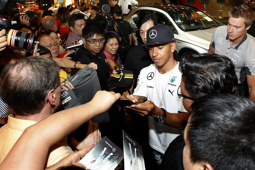 Mercedes driver Lewis Hamilton of Britain meeting fans at Paragon shopping centre yesterday before heading to the Marina Bay Street Circuit. More than 200,000 spectators are expected at the circuit park this weekend.