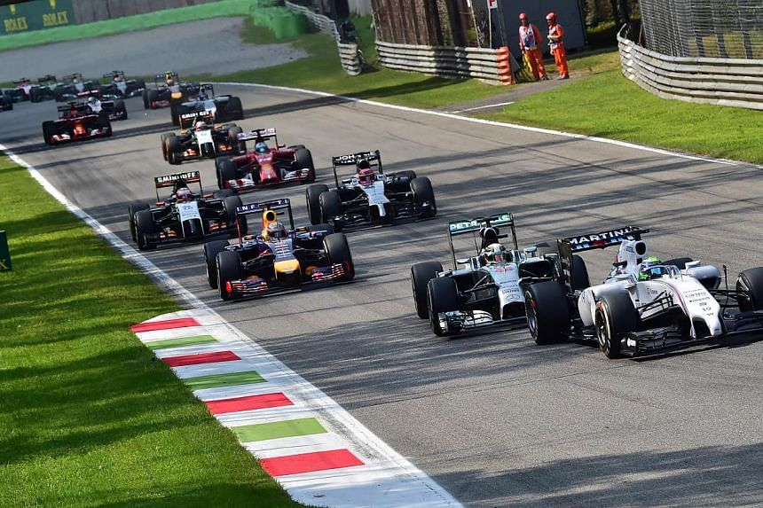 Williams' Brazilian driver Felipe Massa steers his car during the Italian Formula One Grand Prix at the Autodromo Nazionale circuit in Monza on Sept 7, 2014. -- PHOTO: AFP