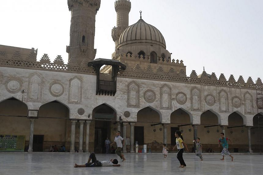 """Children play in the yard of Al-Azhar Mosque in Cairo while their families pray inside the mosque during the holy month of Ramadan on July 1, 2014. Saudi Arabia has agreed to fund the restoration of the mosque in recognition of its role as a """"beacon"""