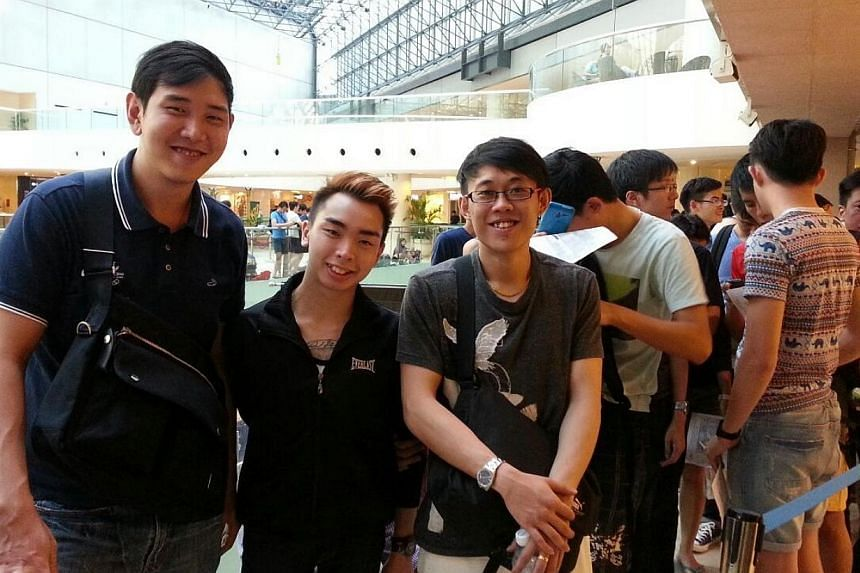 First in the queue at Nubox Raffles City are business development executives (from left) Hung Zhicheng, 25, Ho Yongqing, 20, and Nick Chow, 25. -- ST PHOTO: CHANG MAY CHOON