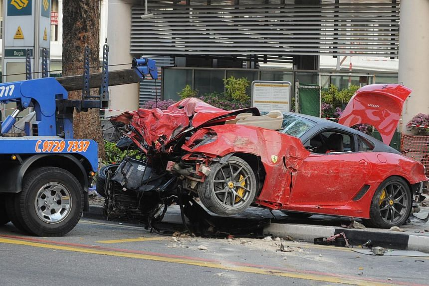 The Ferrari being towed from the scene of the accident, which took place at the junction of Rochor Road and Victoria Street in May 2012. Mr Ma Chi, driver of the sports car, cabby Mr Cheng Teck Hock and his Japanese passenger Shigemi Ito died in the
